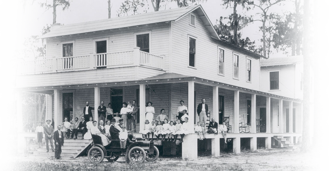 colonial-photograph-of-old-hospital-house-with-people